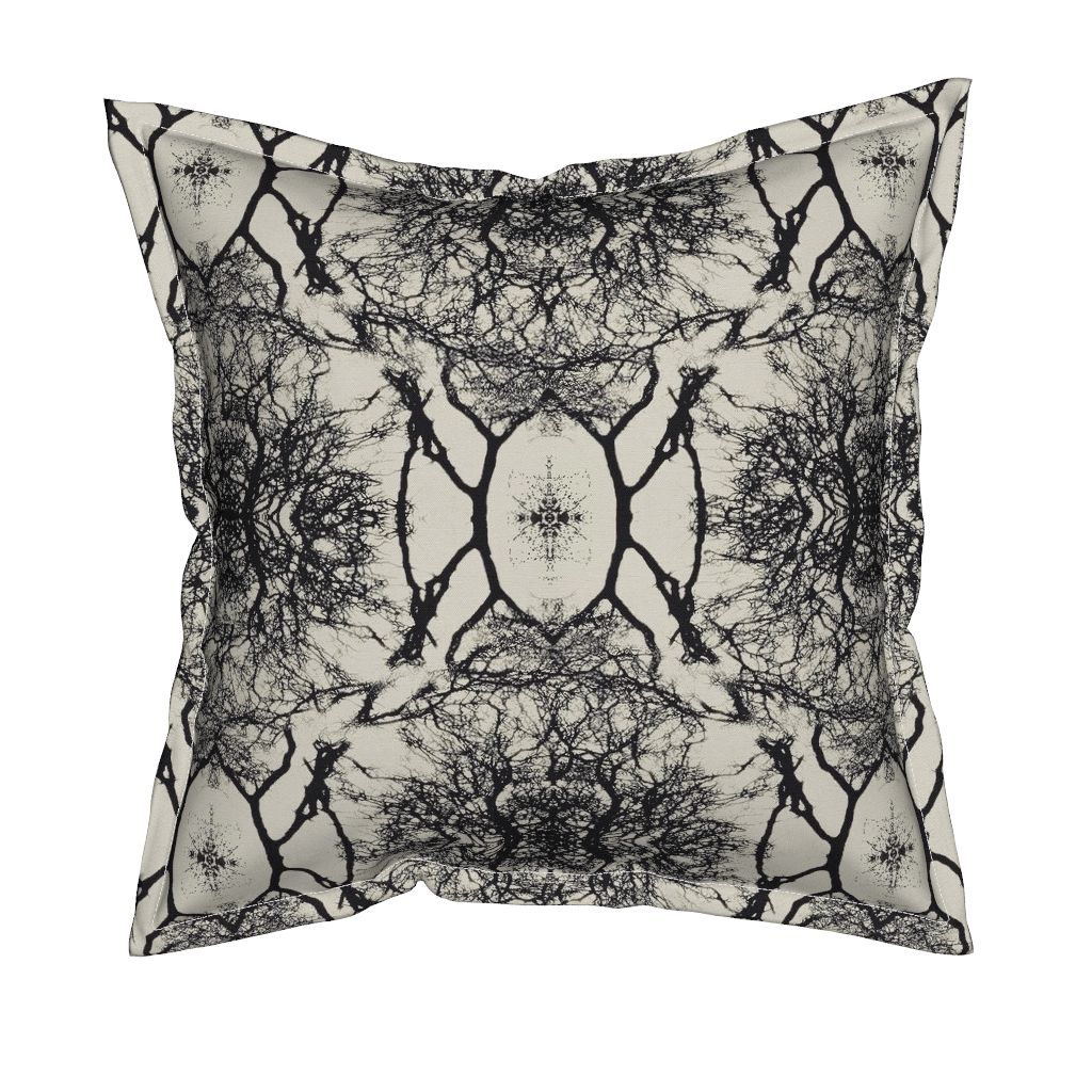 Pillow with dream branches print. Pristine (off white) background color with black artwork.