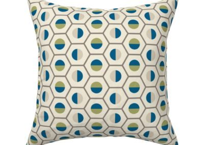 Throw pillow in geometric hexagon shaped color symphony. Colors are green, blue, sand and pristine (off white/beige). Inspired from geometry in nature.