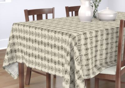 Tablecloth with grail like shapes catching and releasing in a dreamy univers. In pristine (off white) and black color play. One out of three print scales.