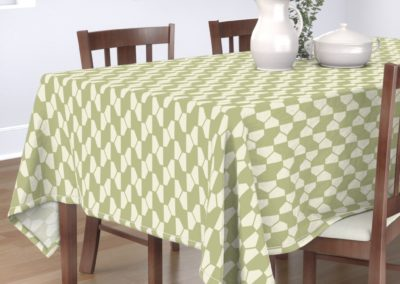 """Geo Ball"" tablecloth with hexagon pattern in green and pristine (off-white/beige) color play. Inspired from geometry in nature."