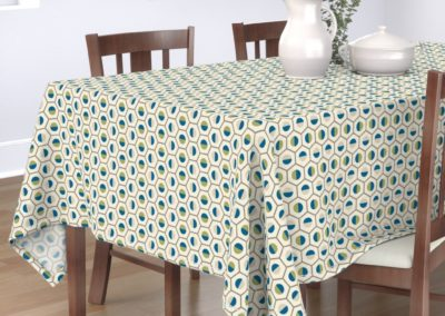 Tablecloth in geometric hexagon shaped color symphony. Colors are green, blue, sand and pristine (off white/beige). Inspired from geometry in nature.
