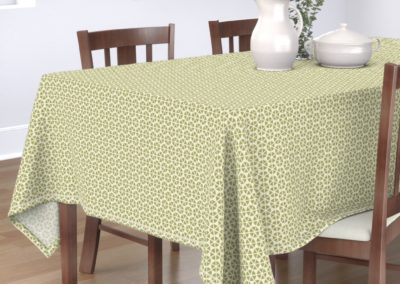 Tablecloth with hexagon shaped geometric flowers. Colors are green and pristine (off white/beige). Inspired from geometry in nature.