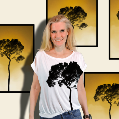 """""""Tree"""" short sleeved blouse made from mtm fabric 152cm x 1meter. Ejm Art FREE Blouse & Sweater XS-XL Pattern"""" was used to cut and sew the blouse. Ground color is white and artwork black. In background photo art posters of the same artwork."""
