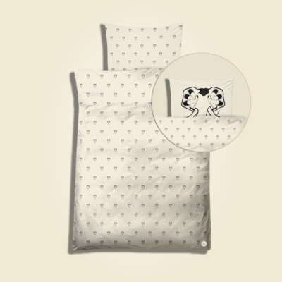Baby bedding with all-over elephant drops print. Black artwork on pristine (off white) background.