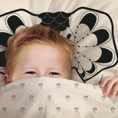Junior sleeping in Elephant Drops duvet cover & pillow cover.