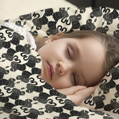 Junior sleeping in Swan Dance duvet cover & pillow cover.
