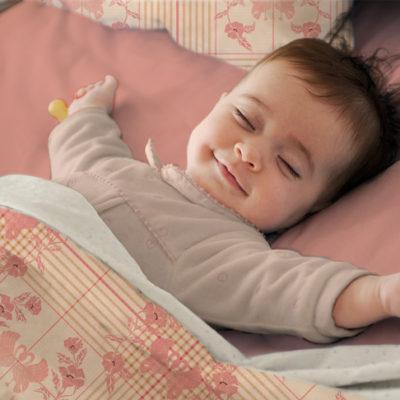 Baby sleeping in Art Check duvet cover.